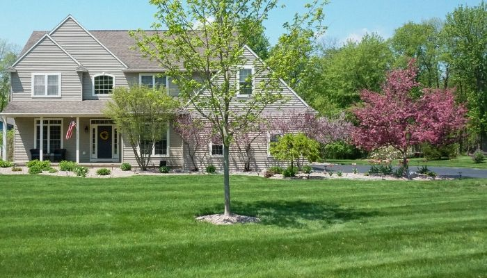A beautiful home in the Syracuse area where the lawn is maintained by a professional lawn care service.